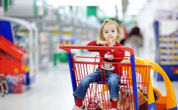 How do I keep my child safe in a shopping cart?