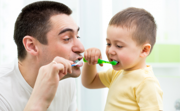 When should I give my child fluoridated toothpaste?