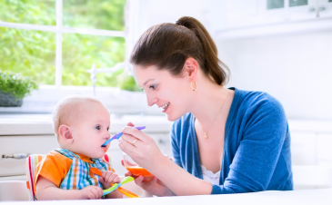 What are the signs that my baby is ready for solids?