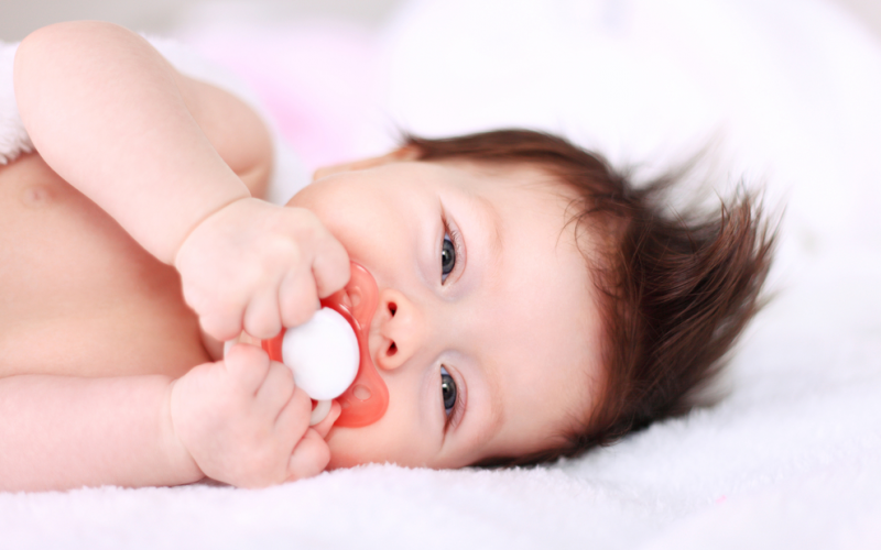 What is a pacifier activated lullaby device?