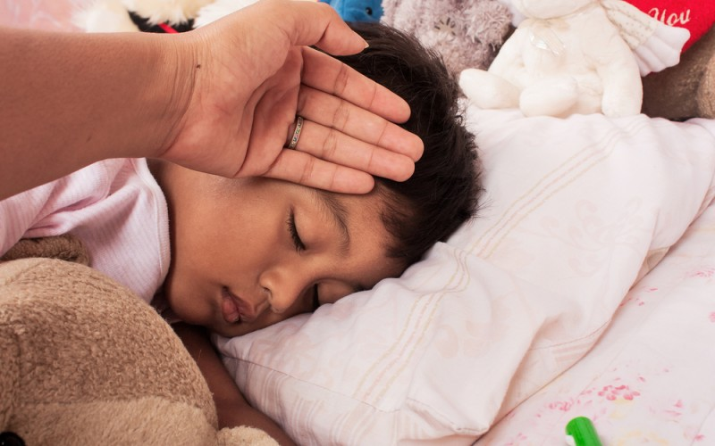 Do I have to treat my child's fever if he is acting fine?